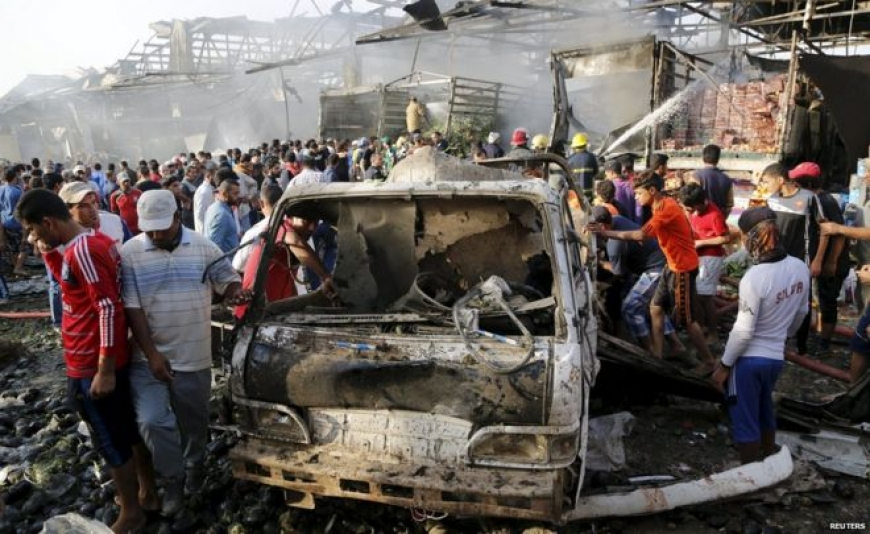 Iraq truck bomb kills dozens at Baghdad market